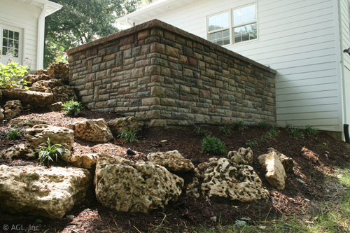 landscaped hill, stone brick wall,stone steps, boulders